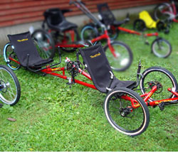 Bright red tandem trike on grass