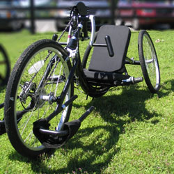 Black hand cycle on grass