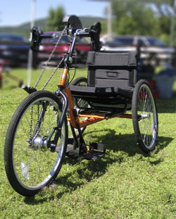 Orange hand cycle on grass