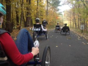 A big group of people ride out on recumbent trikes during the fall