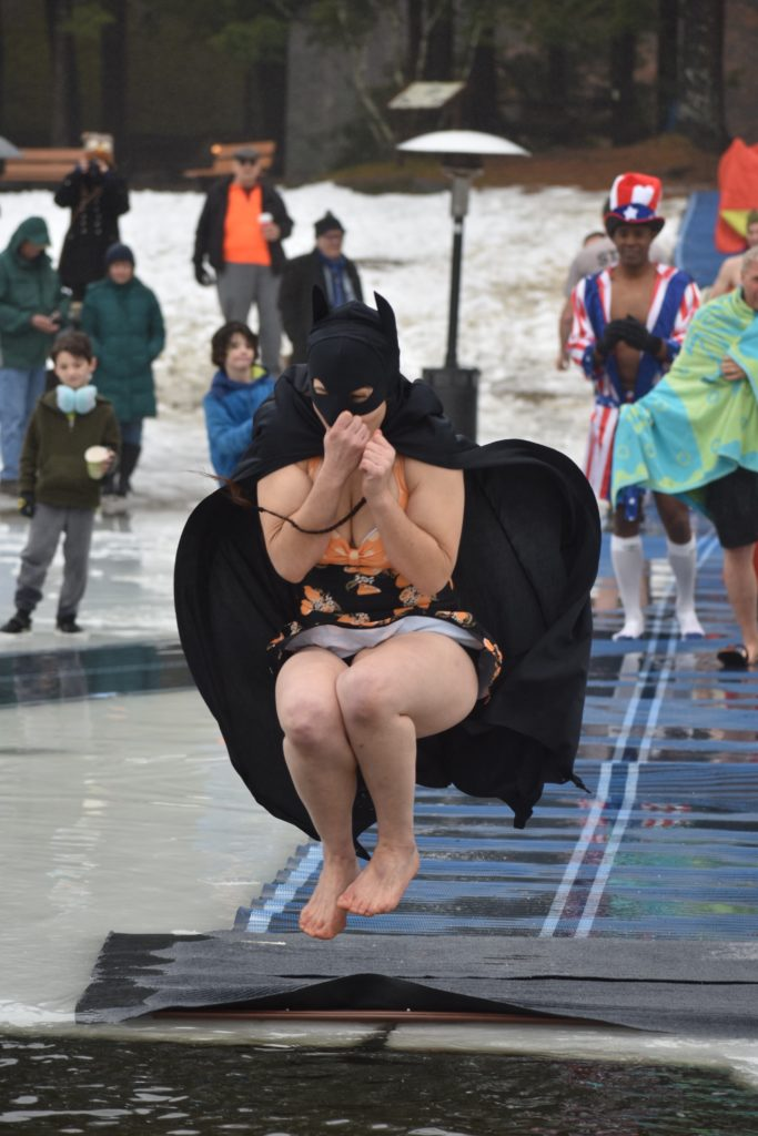 woman dressed as catwoman jumps into lake