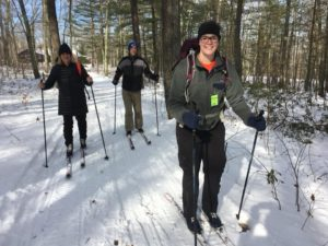 Picture of people cross country skiing at Wendell State Forest.