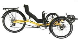 "Stowaway II with 24"" rear wheel. Yellow recumbent trike, two wheels in the front, one in the back, reclined seat."