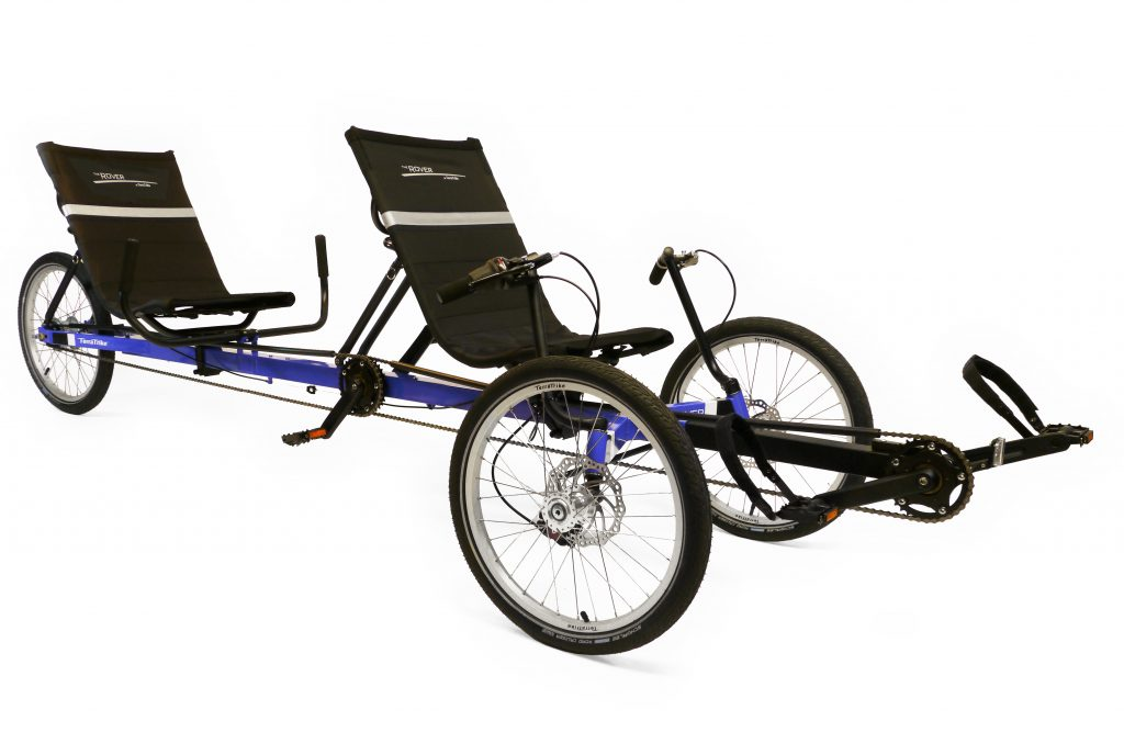 TerraTrike Tandem Rover. Blue trike with two seats and independent pedaling for each rider. Two wheels in the front and one in back.